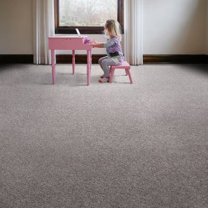 Girl playing piono on carpet flooring | Kopp's Carpet & Decorating