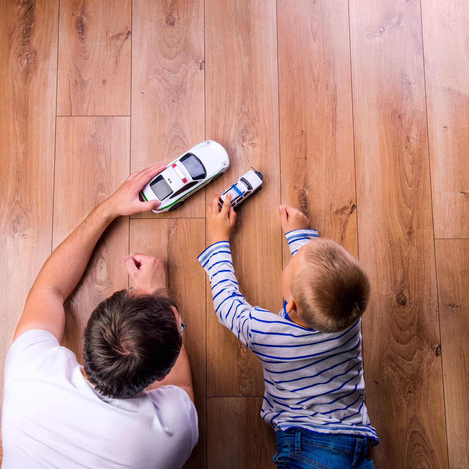 Dad child playing on Hardwood | Kopp's Carpet & Decorating