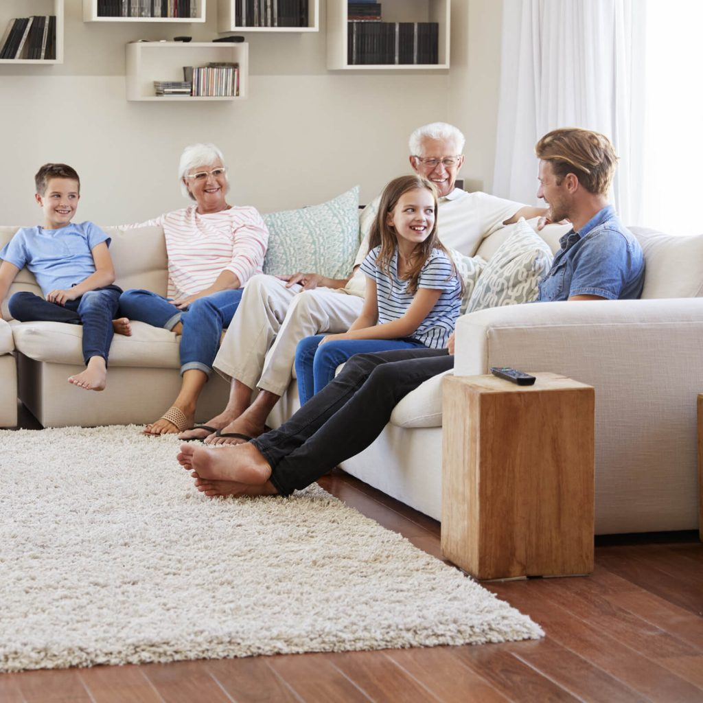 Family get together in living room | Kopp's Carpet & Decorating